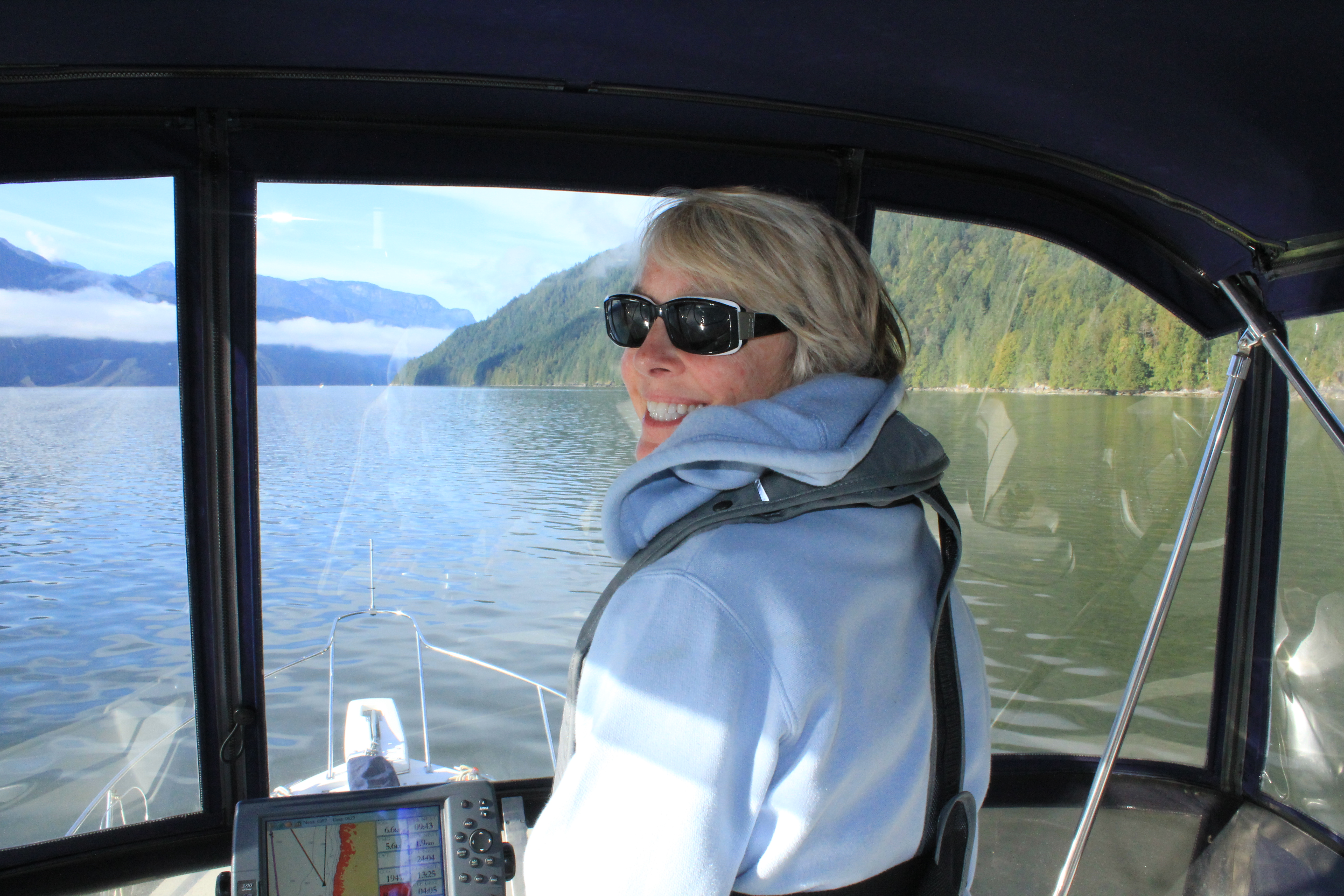Skipper Julia Roberts at the helm while cruising Prince of Wales Reach