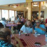 everyone enjoying the picnic semi potluck meal