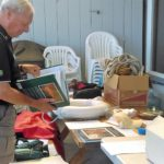 Jim Jones peruses books at the Auction