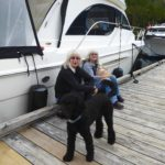 "Sanfy & Patti sitting on the dock with their ""boys"""