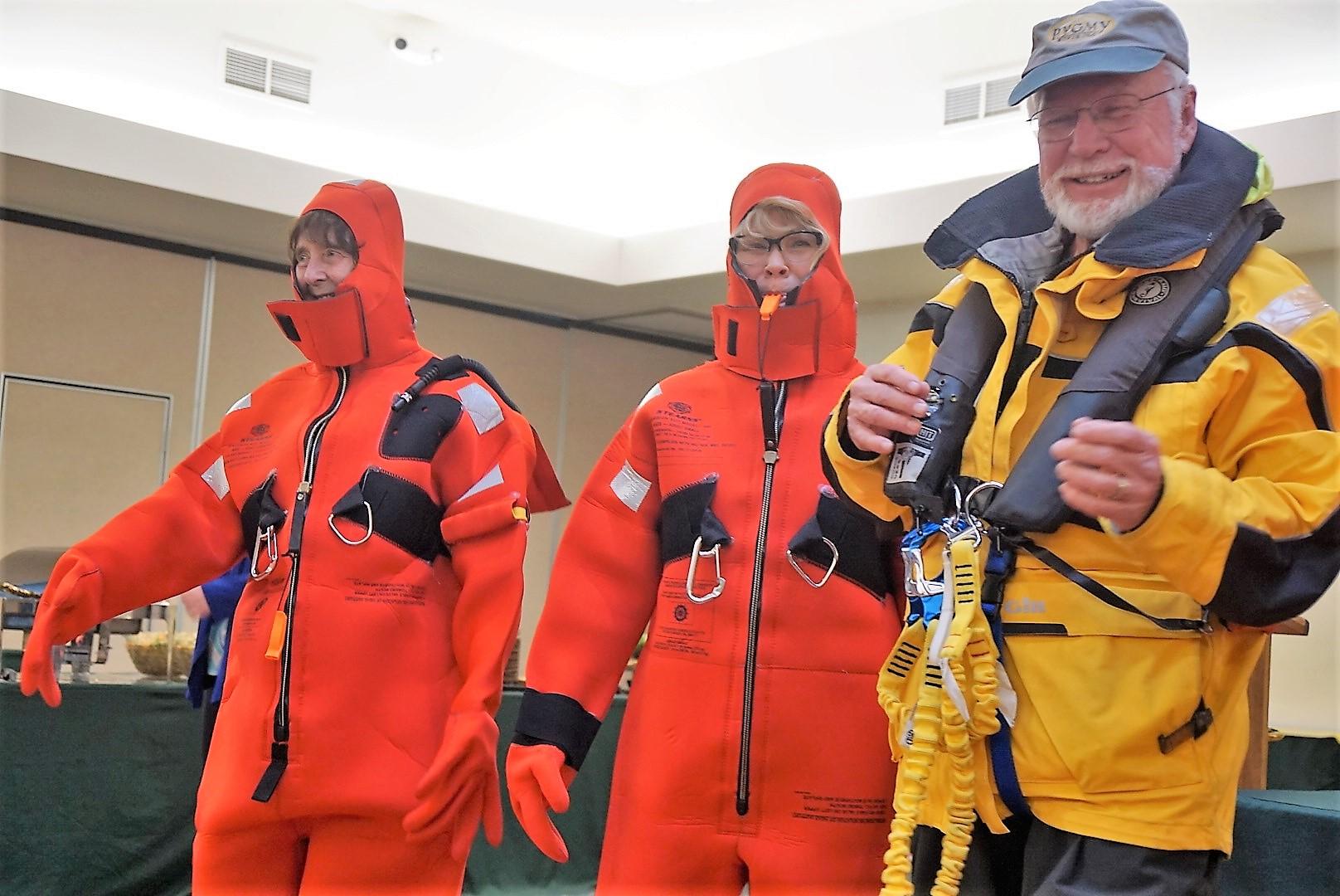 """Volunteers Sally C and Karen M model the """"Gumby"""" suits"""