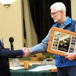 SEO Ray Thomas congratulates Randy Roberts for being awarded the Bob Brummet Educator of the Year award.