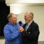 member Torben Blichfield helps COmmander Ray Madsen say goodbye