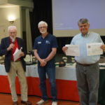Gary Hicks displays certificates for Marine COmmunications