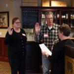 Membership Chair Sandy Thomas swearing in new members The Barnabys