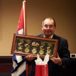 Presenting outgoing Commander Ray Mahalick with a gifts